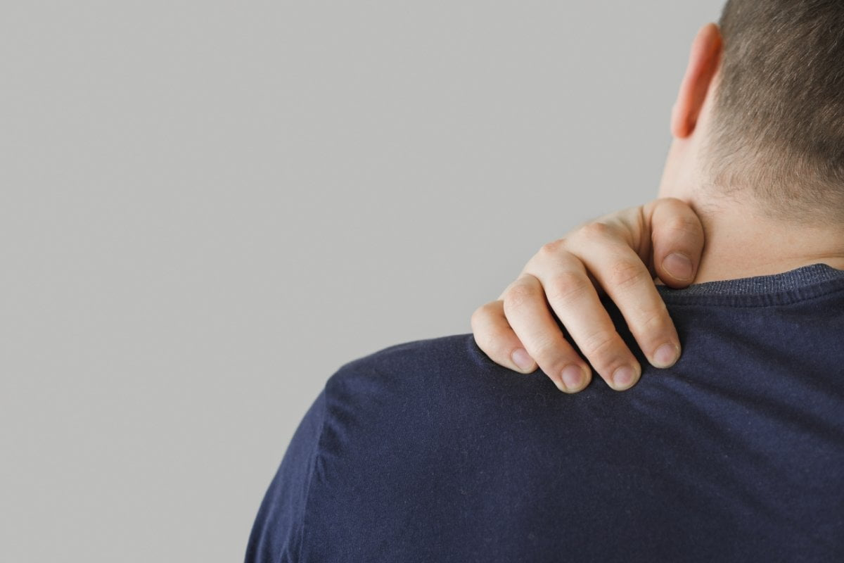 man holding neck back view