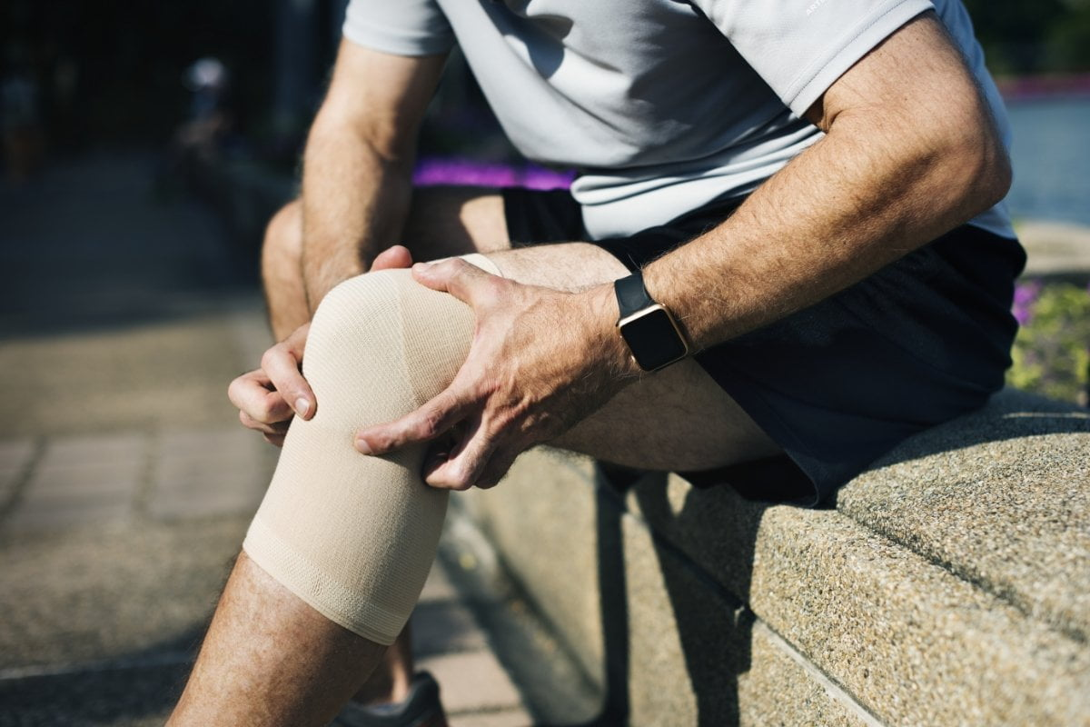 Man with knee bandage