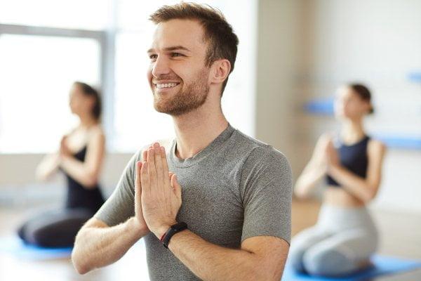 Happy man practicing yoga