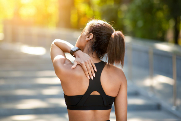 Woman holding back due to muscle strain
