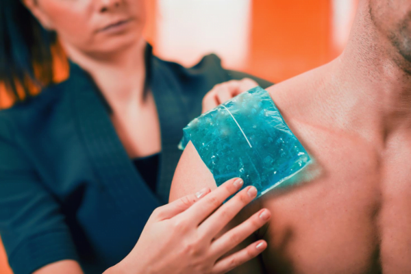 Frozen gel pack being used for pain relief