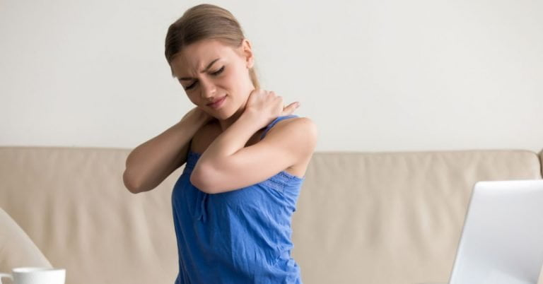 woman holding neck in pain