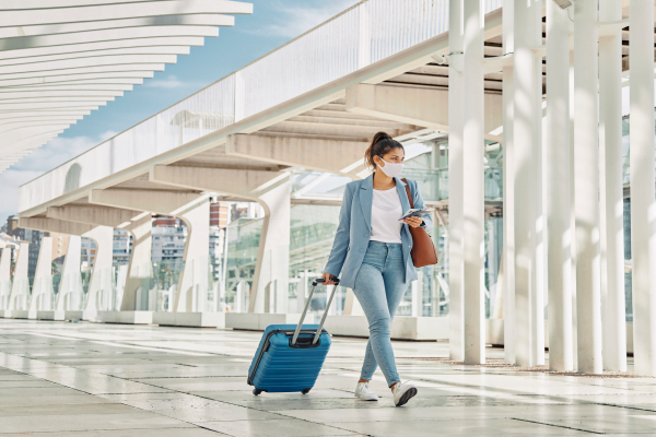 Woman carrying luggage at an airport